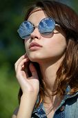 young woman in mirrored sunglasses