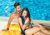 Romantic Couple Enjoying Cocktails At The Pool
