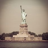 The Statue of Liberty on Ellis Island with retro effect.