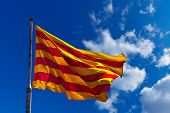 Catalonia Flag On Blue Sky