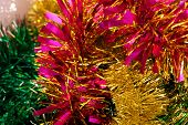 New Year Decoration With Pink, Yellow, Green Tinsel