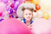 Portrait of lovely little girl posing in playroom