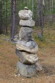Stone Guries (tur, obo) on the glade in the forest. Buryat customs