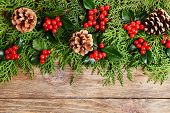stock photo of mistletoe  - Beautiful Christmas border from fir and mistletoe on wooden background - JPG