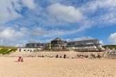Sunny warm weather brought visitors to the coast to enjoy the late autumn sunshine at Fistral beach