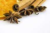 Some Anise Stars And Cassia Cinnamon With Dried Orange Rings