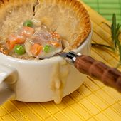 pic of biscuits gravy  - Turkey pot pie with carrot, peas. Selective focus.