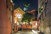 TAIPEI, TAIWAN - November 21th : The lights of Chapel of Presbyterian Church Danshuei at night in Tamsui, Taiwan on November 21th, 2014.