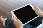Woman hand hold white tablet with blank empty screen