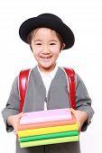 Schoolgirl carrying books