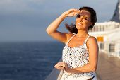 beautiful woman on cruise ship at sunset