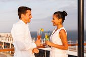 beautiful young couple on a date having drinks on a cruise ship
