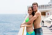 happy young couple on summer holiday on a cruise ship