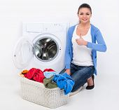 picture of dirty-laundry  - Happy young woman is doing laundry with washing machine at home - JPG