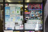 Medicine And Chinese Newspaper And Ads In A Pharmacy In China Town In San Francisco