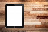 Tablet On Wooden Background
