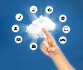Hand Point On Cloud With Icon Against Blue Sky . Cloud Computing Concept