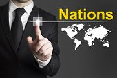 Businessman Pushing Button Nations World