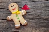 homemade christmas painted ginger breads (gingerbread man) on the wooden background