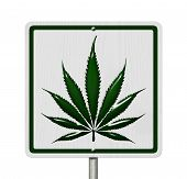 stock photo of marijuana leaf  - Driving Under the Influence of Marijuana A road highway sign with a marijuana leaf isolated on white - JPG