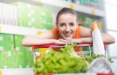 Attractive Woman Leaning On Trolley