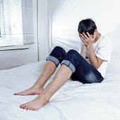 image of sorrow  - Toned Photo of Sorrowful Teenager on the Bed - JPG