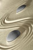zen background japanese garden round stone and lines in sand. Meditation stones for relaxation balance and harmony.