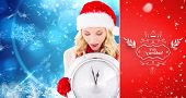 happy festive blonde with clock against red vignette