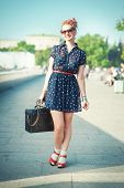 Beautiful Woman In Fifties Style With Braces Smiling