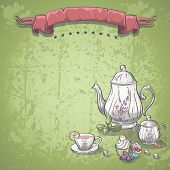 tea service with tea leaves and fruit cakes