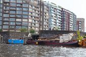 Traditional House Boat On The Canals Of Amsterdam.
