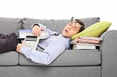 Male accountant sleeping on a pile of folders isolated on white background