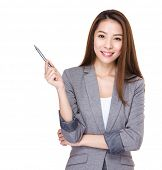 Businesswoman hold with a pen