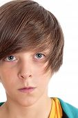 Closeup Portrait Of A Teenage Boy, Isolated On White