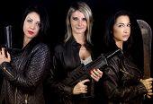 three women rebels dressed leather