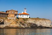 Постер, плакат: Lighthouse And Wooden Buildings On St Anastasia Island