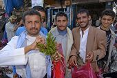 Men buy khat (Catha edulis) at the local market in Lahij Yemen.