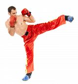 foto of kickboxing  - Kickbox or muay thai instructor executing a kick isolated on white background - JPG