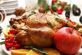 Baked chicken for festive dinner. Christmas table setting