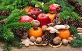 pic of walnut-tree  - Apples mandarine fruits walnuts cookies and spices with christmas tree branches - JPG