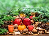 Christmas Decoration With Candles. Fruits And Cookies