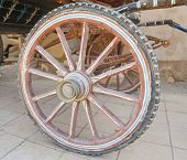 foto of carriage horse  - Closeup detail of wheel on old vintage horse drawn carriage - JPG