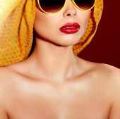 Beautiful Woman In Sunglasses And Shawl.