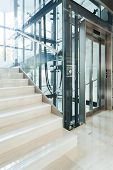 picture of elevators  - Glass elevator in the modern business office - JPG
