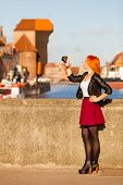 Woman Taking Photo Picture With Camera In Old Town Gdansk