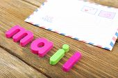 Mail word formed with colorful letters on wooden background