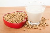 image of soybean milk  - Soy milk in glass with soybeans in heart shape box on wood table - JPG