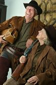 image of gunslinger  - Two smiling hunters in western clothes - JPG