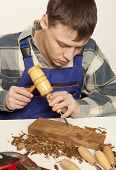 picture of carpentry  - Young craftsman in uniform working at carpentry - JPG