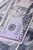 foto of fifties  - fifty dollars banknotes as a background close - JPG